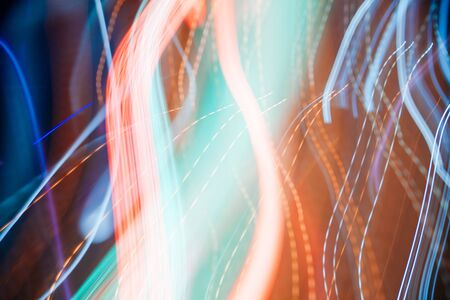 Colorful pattern of blue and orange dynamic lines of light. Modern blurred background. Art concept of lighting effects. Archivio Fotografico - 129215269