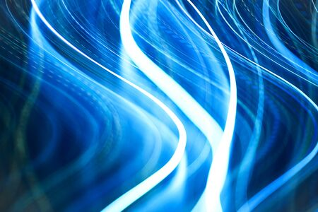 Colorful pattern of blue dynamic neon lines. Modern background. Art concept of lighting effects. Zdjęcie Seryjne