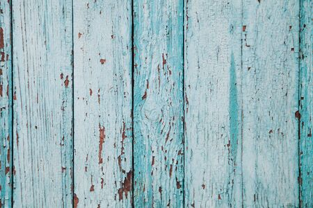 Wooden fence of blue color with cracks and texture of old paint. Background for your design Zdjęcie Seryjne