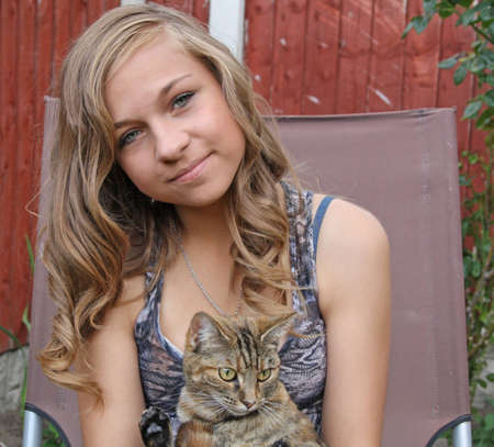 beautiful girl with her kitten  photo