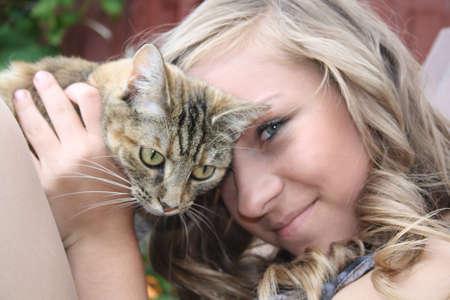 teenage girl with her cat Stock Photo - 10463447