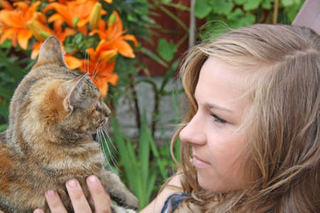 pretty girl with her cat Stock Photo - 10463450