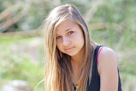 briskness: pretty teenage girl sat in woods