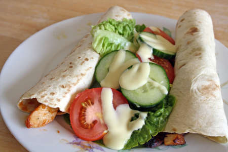 chicken wraps and  salad  photo