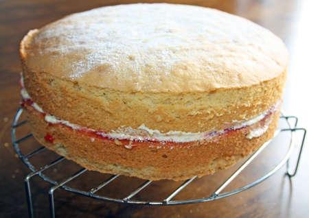 sponge cake with jam and cream photo