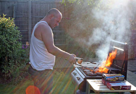 man cooking at the bbq photo