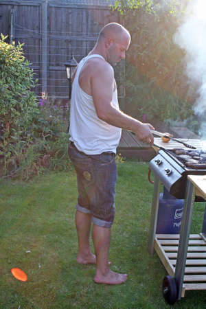 man cooking at the bbq Stock Photo - 14710509
