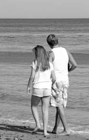 teenagers walking along the beach photo