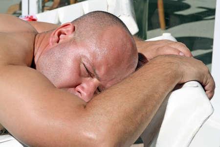 sun bathing: man sun bathing