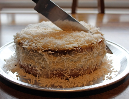 cutting coconut cake  photo