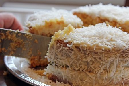 coconut cake being cut