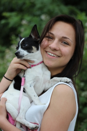 pretty girl with dog in her arms  photo