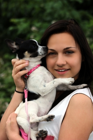 pretty girl with pet dog photo