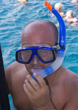 man going snorkling