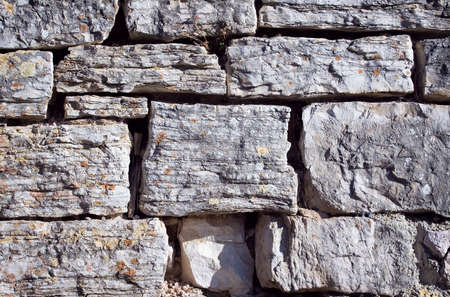 Old grunge stone wall close up photo