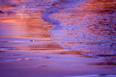Small wave on a beautiful sand beach at sunset time Stock Photo - 851740