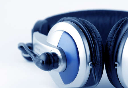 vibrations: Headphones with microphone over white background Stock Photo