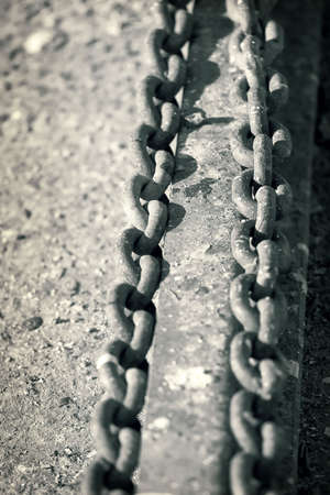 Two rusty metal chains close up , black and white toned photo Stock Photo - 2660313