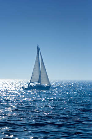 A small  boat sailing on a sunny morning Stock Photo