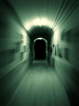 Moving trough long dark underground corridor. Zoom motion effect photo.