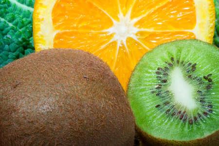 Fresh fruits close up photo , kiwi and orange photo