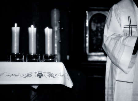 Catholic Priest and the  altar during  Mass , black and white photo photo