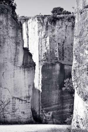 eyesore: Old abandoned stone quarry - black and white toned photo