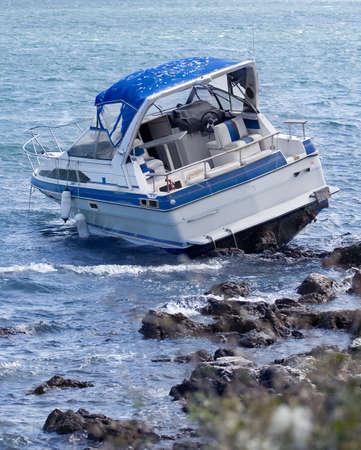 Motorboat crash on rocky shore