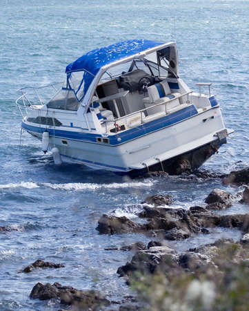 Motorboat crash on rocky shore
