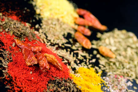 ingradient: Close up of various mixed spices on dark kitchen table