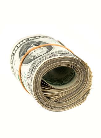 Money background - US dollars rolled on white background.  photo