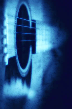 Grunge textured blue guitar background with space for your text photo