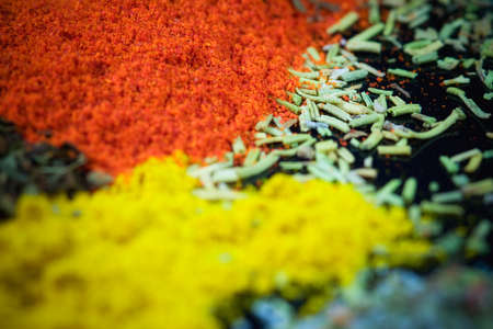 ingradient: Close up of various mixed spices on dark kitchen table..