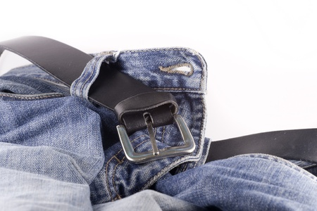 Blue jeans and a black leather belt over white background Stock Photo - 20005257