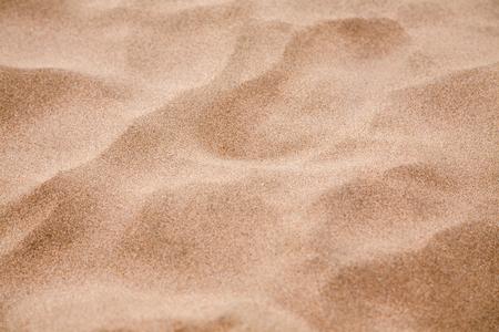 Zandstrand textuur. Zandstrand voor achtergrond.