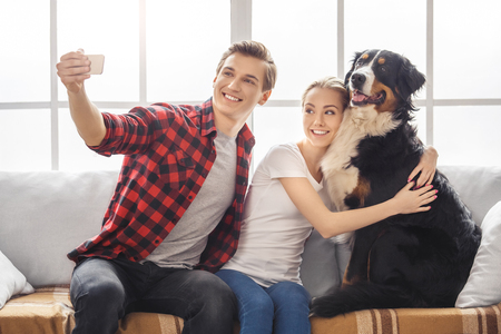 Young people with dog at home leisure