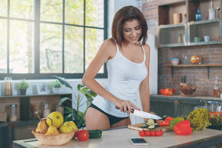 Young sexy woman in the kitchen lifestyle