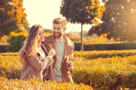 Young couple walk in the autumn park
