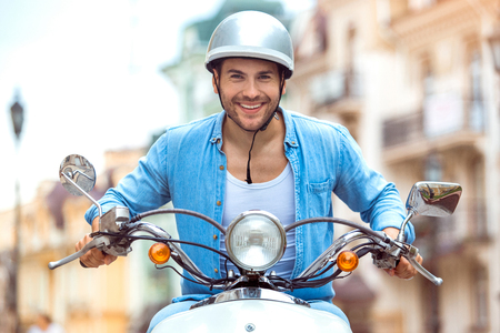 Young male driver traveler on scooter transportation Stock Photo