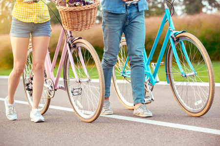 Couple riding bicycle together active lifestyle concept