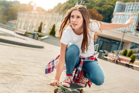 Young woman with skateboard outdoors active lifestyle