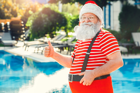 Santa Claus near the pool holiday vacation concept Фото со стока