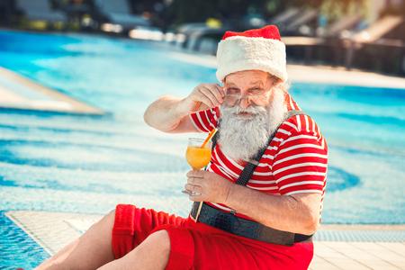 Santa Claus near the pool holiday vacation concept Stock Photo