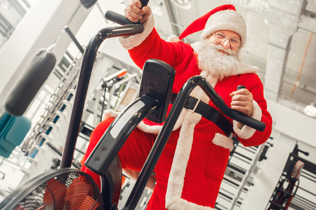 Santa Claus in the gym holiday concept