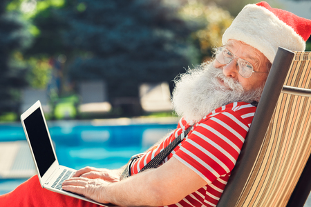 Santa Claus near the pool holiday vacation concept Фото со стока