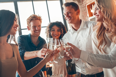 Group of friends party together indoors celebration Stock Photo