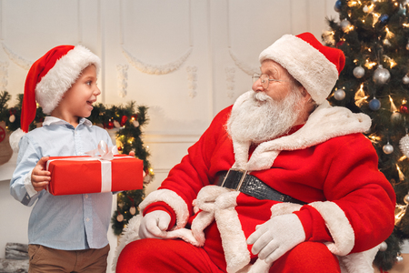 Santa Claus with kids indoors christmas celebration concept Stock Photo