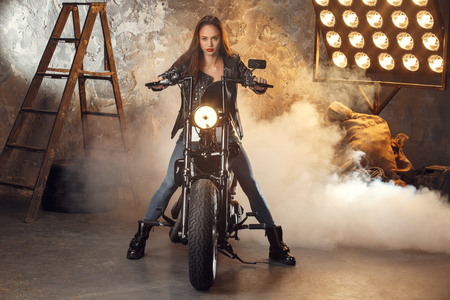 Young woman with motorcycle studio