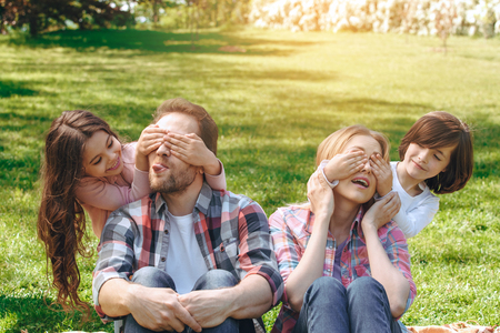 Family together outdoors in the park weekend concept surprise Stockfoto