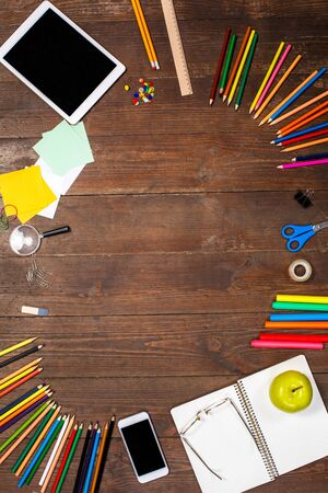School education objects isolated on wooden table